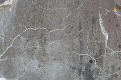 Textur av den gråa granitplattan med sprucken yttersida för designmodell för bakgrund färgrik swirl arkivfoto