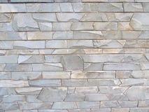 Textur av den gråa stenväggen Fotografering för Bildbyråer