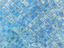 Textur av den lilla fyrkantiga keramiska tegelplattan arkivbild