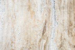 Textur av den naturliga stenen (Travertine) för bakgrundsdesign Royaltyfri Fotografi