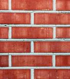 Textur av den röda moderna tegelstenväggen med cementlager Arkivbilder