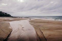 Textur av den sandiga stranden Arkivfoto