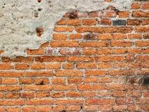textur av den spruckna tegelstenväggen Arkivfoto