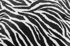 Textur av den svartvita sebratextilen Arkivfoto