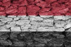 Textur av den Yemen flaggan på ett dekorativt skäll royaltyfria foton