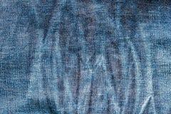 Textur av det gamla jeanstextilslutet med bleknar upp Royaltyfri Bild