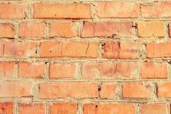 Textur av en bakgrund för tegelstenvägg i bygden grova kvarter av det horisontalstentegelstenmurverket Arkitekturtapet arkivbild