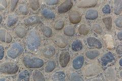 Textur av en bana från flodstenar Arkivfoto