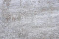 Textur av en betongvägg med sprickor och skrapor som kan användas som en bakgrund royaltyfri fotografi