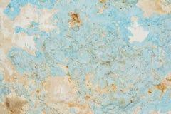 Textur av en gammal blå vägg, rappar skadat vid exponering till fuktighet, abstrakt bakgrund Royaltyfri Fotografi