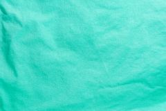 Textur av en grön bomullsfiberyttersida som bildar ett tyg, abstrakt bakgrund Royaltyfria Bilder