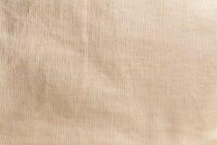Textur av en gul bomullsfiberyttersida som bildar ett tyg, abstrakt bakgrund royaltyfri foto