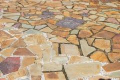 Textur av en mosaikstentrottoar Arkivbilder