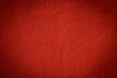 Textur av en röd betong Arkivfoto