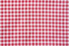 Textur av en röd och vit rutig bordduk Fotografering för Bildbyråer