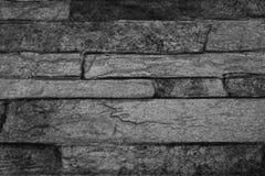 Textur av en stenvägg i svartvita färger Royaltyfri Bild