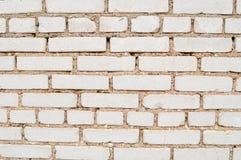 Textur av en tegelstenvägg med rektangulära beigea tegelstenar av olika format med cementsömmar royaltyfri fotografi