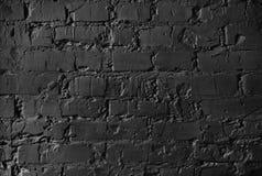 Textur av en tegelstenvägg murverk med cementsömmar av svart färg arkivbild
