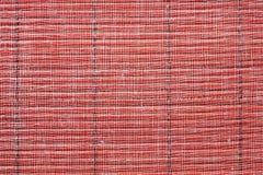 Textur av ett mattt rött sugrör Royaltyfria Bilder