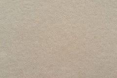 Textur av ett papp- eller pappersmaterial av beige färg Royaltyfri Bild