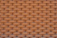 Textur av ett staket av orange lerategelstenar Royaltyfria Bilder