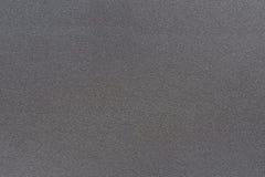 Textur av färg för mörk svart för metall har grov yttersida, abstrakt bakgrund Fotografering för Bildbyråer