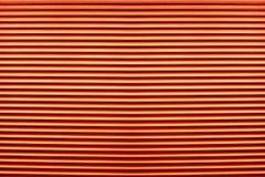 Textur av färgrik orange plast- stänger med fönsterluckor för abstrakt beståndsdel Royaltyfri Bild