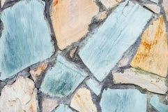 Textur av färgrika stenar masonry ungefärlig yttersida royaltyfri fotografi