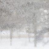 Textur av frostat exponeringsglas. Vinterbakgrund. Arkivfoto