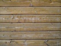 Textur av gamla grå färger bryner väggen av horisontalträbräden arkivbild