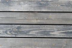 Textur av gamla gråa wood plankor royaltyfria foton