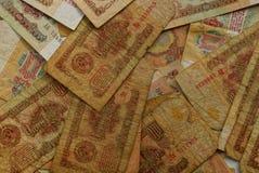 Textur av gamla gula sovjetiska pengarräkningar Arkivbilder