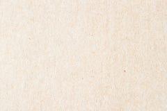 Textur av gammalt organiskt papper för ljus kräm Återvinningsbart material med små medräknanden av cellulosa bakgrund bakgrund royaltyfria bilder