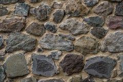 Textur av gammalt vaggar väggen för bakgrund, medeltida stenvägg Royaltyfria Bilder