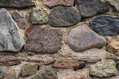 Textur av gammalt vaggar väggen för bakgrund, medeltida stenvägg Royaltyfri Fotografi