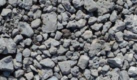Textur av gråa stenar i solen royaltyfria bilder
