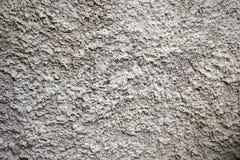 Textur av grov cementyttersida arkivbilder