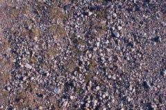 Textur av grus i vägen arkivfoto