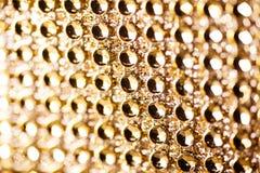 Textur av guld- juvlar för bakgrund Royaltyfria Bilder