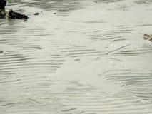 Textur av havsstranden med vaggar Royaltyfri Foto