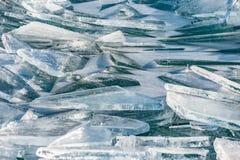 Textur av isyttersida, sprucket sväva för is Arkivfoto