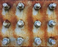 Textur av järnplattan med skruvar Fotografering för Bildbyråer