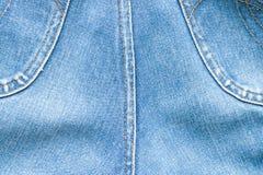 Textur av jeans och häftklammeren Royaltyfria Bilder