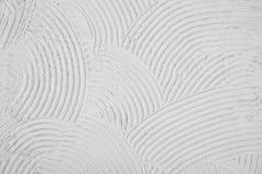 Textur av krökningbåglinjen, grov vapenvitbakgrund Arkivfoton