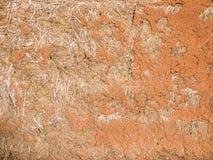 Textur av leraväggen av hem- jord, slut av naturliga byggnadsmaterial som göras av lera, är upp energi-besparingen Royaltyfria Foton