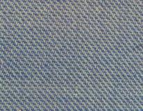 Textur av mång- färgtyg med den vanliga modellen som används som bakgrund Arkivfoto