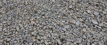 Textur av många krossade stenar Den krossade stenen är ett fast grundmaterial för fundament Royaltyfri Bild