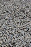 Textur av många krossade stenar Den krossade stenen är ett fast grundmaterial för fundament Fotografering för Bildbyråer
