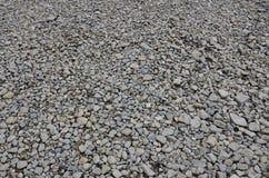 Textur av många krossade stenar Den krossade stenen är ett fast grundmaterial för fundament Arkivbild