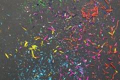 Textur av mångfärgade färgstänk på en svart bakgrund royaltyfri bild